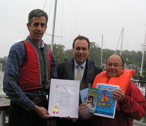 Town of Greenwich First Selectman Peter Tesei (center) proclaims the week of May 19 as Safe Boating Week. Receiving the proclamation are GSPS Commander David Cassuto (left) and GSPS Safety Officer Art Steinberg.